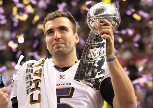 Feb 3, 2013; New Orleans, LA, USA; Baltimore Ravens quarterback Joe Flacco (5) celebrates with the Vince Lombardi Trophy after defeating the San Francisco 49ers 34-31 in Super Bowl XLVII at the Mercedes-Benz Superdome. Mandatory Credit: Matthew Emmons-USA TODAY Sports