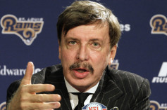 St. Louis Rams owner Stan Kroenke speaks during a news conference where Jeff Fisher was officially introduced as the new head football coach of the St. Louis Rams NFL team, in St. Louis, Tuesday, Jan. 16, 2012. (AP Photo/Tom Gannam)