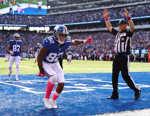 EAST RUTHERFORD, NJ - OCTOBER 16: Roger Lewis #82 of the New York Giants celebrates a touchdown against Tavon Young #36 of the Baltimore Ravens in the second quarter during their game at MetLife Stadium on October 16, 2016 in East Rutherford, New Jersey. (Photo by Al Bello/Getty Images)