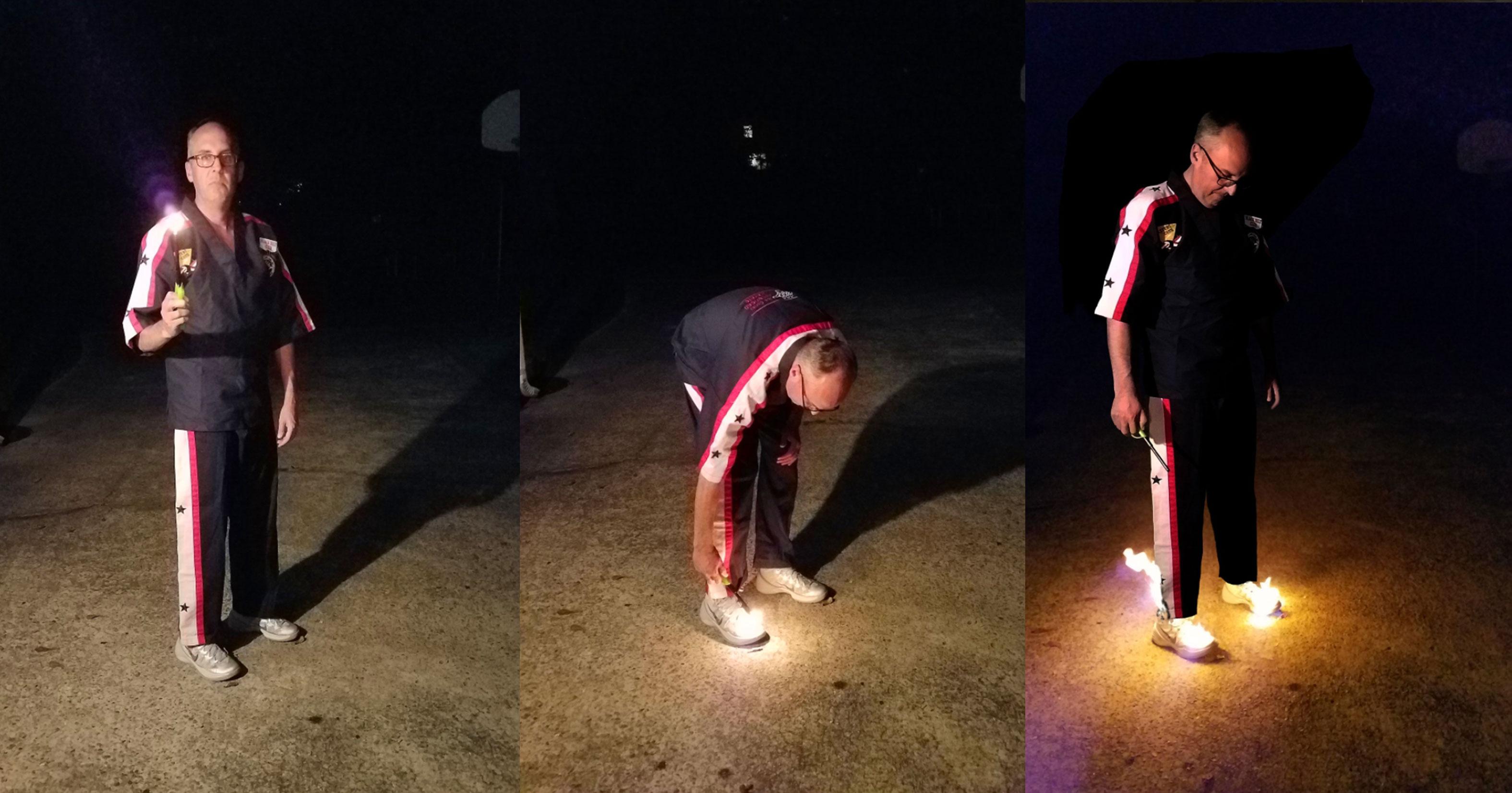 Man Burns His Nike Shoes While Wearing